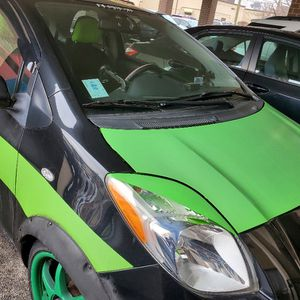 Toyota yaris 2008 customized with navigation, back up camera, subwoofer, dashcam, 17inch alloy wheels, 120v inverter, bike rack, MANUAL TRANSMISSION for Sale in Chicago, IL