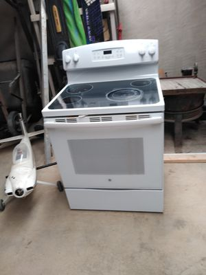 "Table saw 10"", boat motor and a stove for Sale in Greeley, CO"