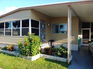 Beautiful 2 bed/ 2 bath double wide mobile home in Port Richey in highly desirable Suncoast Gateway park for Sale in Port Richey, FL