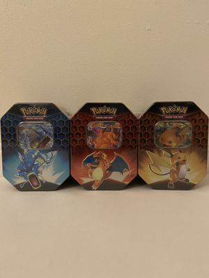 Pokemon Hidden Fates Tin Set of 3 CHARIZARD GYARADOS RAICHU TCG 12 BOOSTER PACKS for Sale in Centreville, VA