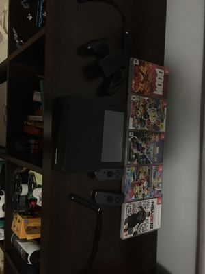 Nintendo switch with only right joycon left one broke and games for Sale in San Francisco, CA