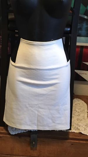 New women's size L Attention white stretchy mini skirt located off lake mead and jones area asking $3 for Sale in Las Vegas, NV