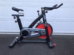 Sunny Health & Fitness 49 Lb Chromed Flywheel, Silent Belt Drive Indoor Cycle Bike with Leather Resistance Pad for Sale in Portland, OR