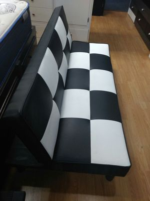 Twin futon couch bed made in black and white as well as all black for Sale in Los Angeles, CA