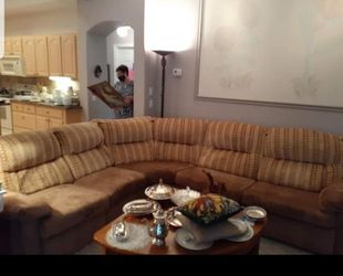 Sectional with Sleeper and Recliner for Sale in Tampa,  FL