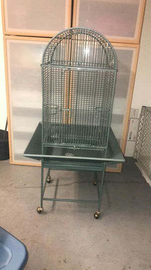Rolling bird cage size 53 inches high from bottom gate size is 30x18x18 for Sale in Orlando, FL