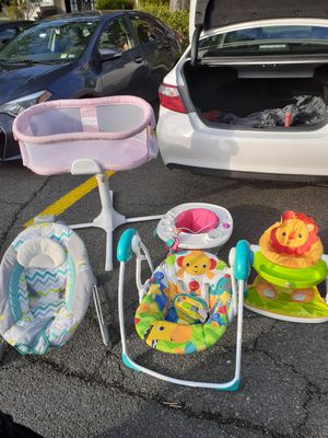 Baby bed and baby swings and baby sit ups for Sale in Alexandria, VA