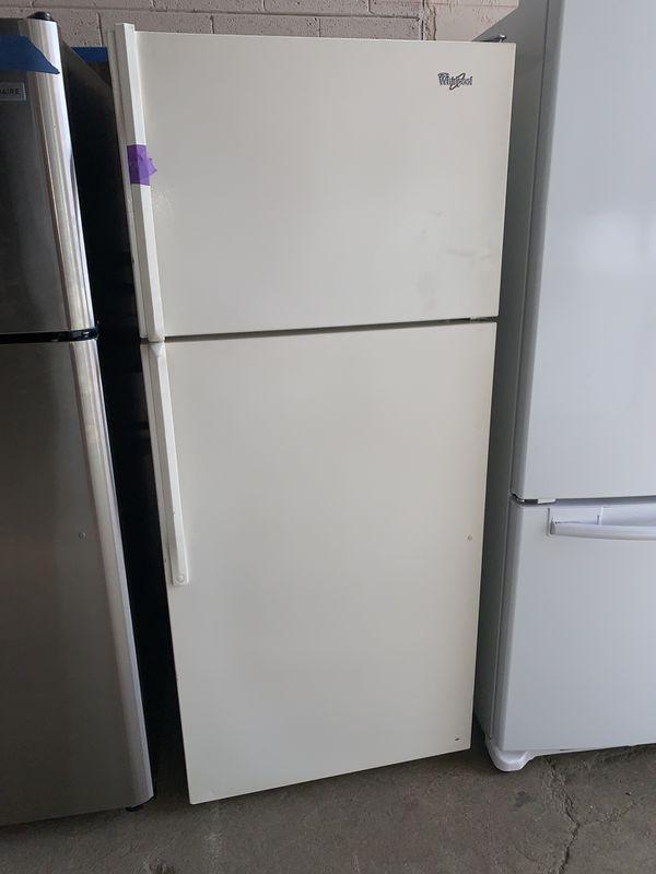 WHIRLPOOL beige top freezer refrigerator in excellent conditions