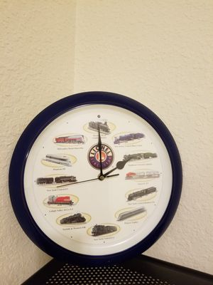 Clock with train pictures and sound. Has an Alarm system as well. for Sale in Stockton, CA