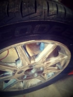 Cadillac rim and tire 5 lug like new reduced price for 75 for Sale in Nashville, TN