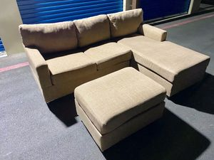 TAN SECTIONAL COUCH WITH OTTOMAN DELIVERY AVAILABLE for Sale in Las Vegas, NV