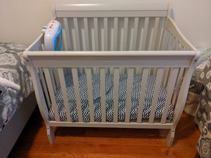 Grey mini crib with mattress like new for Sale in Brooklyn, NY