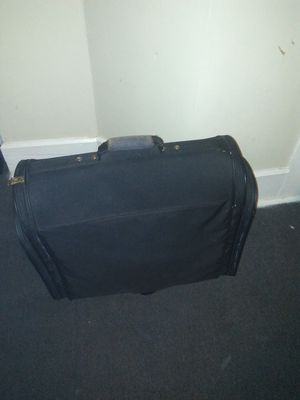 Huge Suit Case on wheels clean no tairs all zippers work the brand is American Tourist for Sale in Evansville, IN