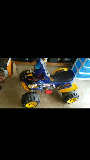 Toy car with bettery and changer for Sale in Alexandria, VA