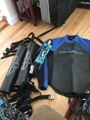 O'Neil thick woman's wet suit top, Sakal soft surfboard car carriers, and brand new BPS 8in storm leash for Sale in San Diego, CA