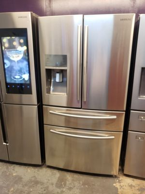 Samsung stainless steel french door refrigerator with showcase door for Sale in Katy, TX