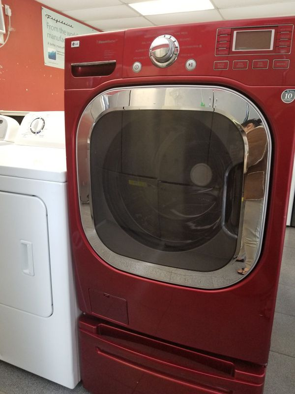Kenmore red front load washer on pedestal