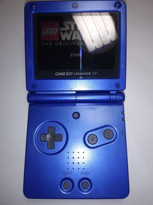 Cobalt blue gameboy advance sp in great condition + Star Wars 2 the original trilogy for Sale in Riverside, CA