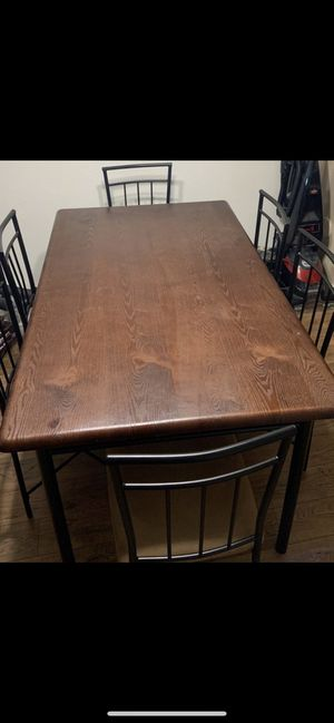 Wood top metal base kitchen dinning table with 6 chairs for Sale in Chandler, AZ