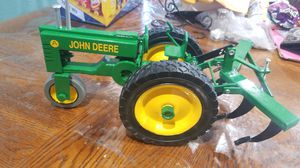John Deere metal tractor with tool for Sale in Carson, CA