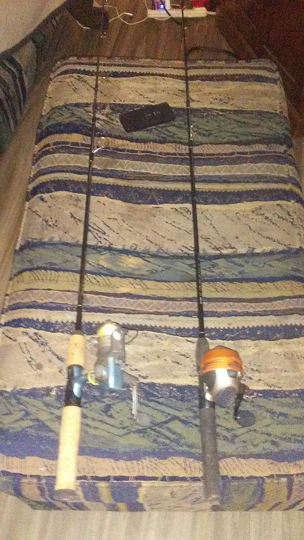 1 open face 1 close face fishing reel and rods