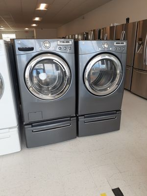 Lg front load washer and electric dryer set with pedestal in excellent condition with 90 day's warranty for Sale in Mount Rainier, MD