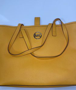 Michael Kors Jet Set Yellow Travel Tote Retails for +$230 for Sale in Miami,  FL