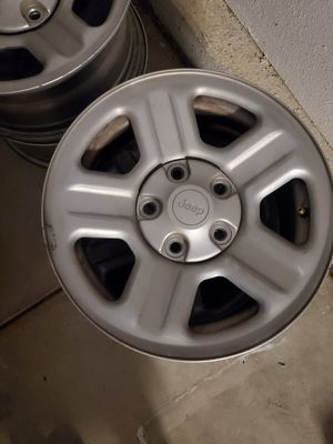Set of 5 jeep steele stock wheels with center caps for Sale in Modesto, CA