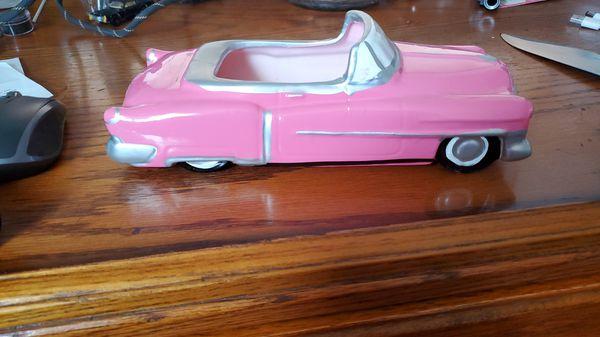 Mann Cadillac convertible flower pot