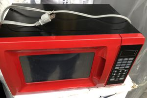 like new red 0.7 cu ft 700W microwave for Sale in The Woodlands, TX