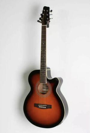 This Stagg Mini-Jumbo Electric-Acoustic Cutaway Concert Guitar is a great choice for the aspiring guitarist. The convenient cutaway gives you better for Sale in San Diego, CA