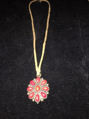 Great necklace with red stones in a metal charm for Sale in Los Angeles, CA