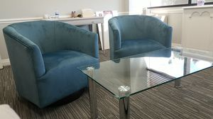 Light blue microfiber swivel barrel chairs and glass with chrome coffee table for Sale in Boca Raton, FL