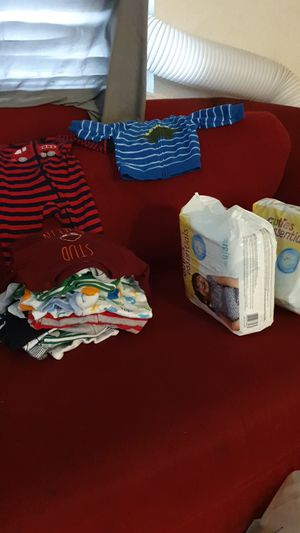3 packs of size 4 diapers and bag of newborn boy clothes for Sale in Gardena, CA