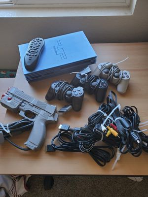 Rare Japanese Playstation 2 PS2 Aqua Blue with controllers and Namco Light Gun for Sale in Denver, CO