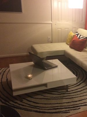 Coffee table glossy white has a few scratches on the side but overall looks great please let me know if you interested thanks for Sale in Silver Spring, MD
