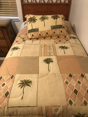 2 like new twin size comforter sets...includes comforters matching sheet sets, shams and bed skirts $50 each...Beds not being sold for Sale in Port St. Lucie, FL