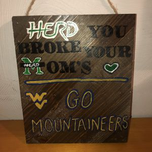 NEW WITH TAGS Jillibean large wooden Marshall Herd & WV Mountaineers hand painted sign/picture/decoration with a rope strap to hang it on the wall for Sale in Saint Albans, WV