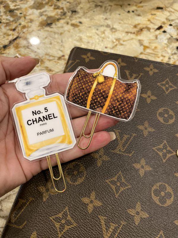 Designer agenda paper clips. 7 total. Lv and Chanel