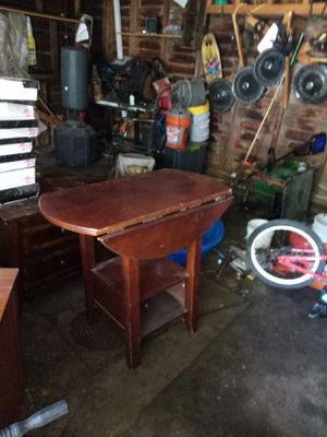 Dining room table. Both sides fold down. Sturdy for Sale in Lakewood, OH
