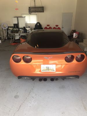 Dark smoke taillights C6 corvette factory headlights!-dark smoke can be removed for Sale in Saginaw, MI
