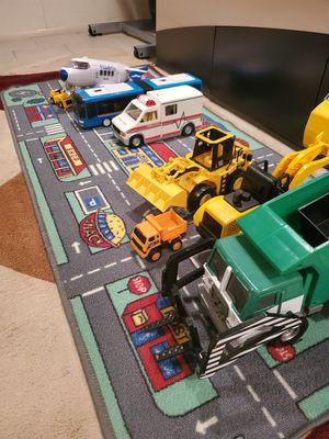 Kids toy trucks with play matt for Sale in Philadelphia, PA