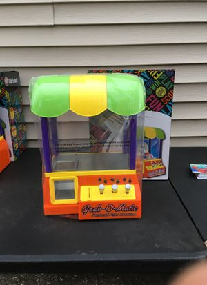 A brand new Dave and busters claw machine for Sale in Mason City, IA