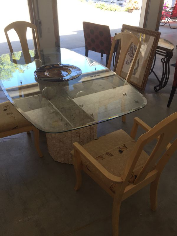 Dining room beveled glass table with stone bases