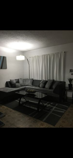 GREY AND BLACK USED SECTIONAL SOFA, ONE SIDE TABLE AND COFFEE TABLE INCLUDED NICE AND MODERN for Sale in Miami, FL