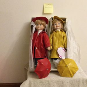 Collectible Porcelain Doll - Pair With rain Wear And Umbrellas for Sale in Lombard, IL