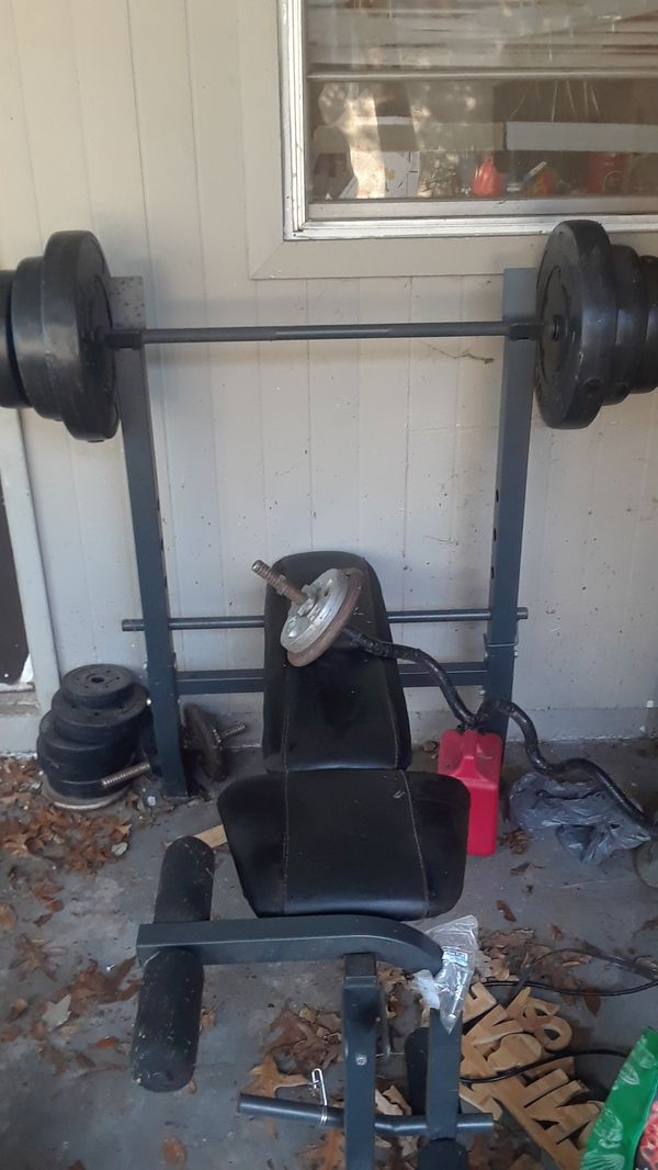 weight bench,bar,curl bar,and some weights
