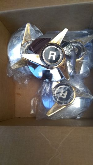 Rim center caps chrome and gold for Sale in Denver, CO