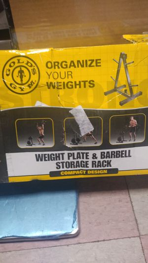Gold's Gym weight plate and barbell storage rack compact design for Sale in Philadelphia, PA
