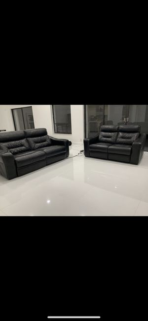 High End black leather reclining sofa and love seat. I paid $4700 for Sale in Boca Raton, FL